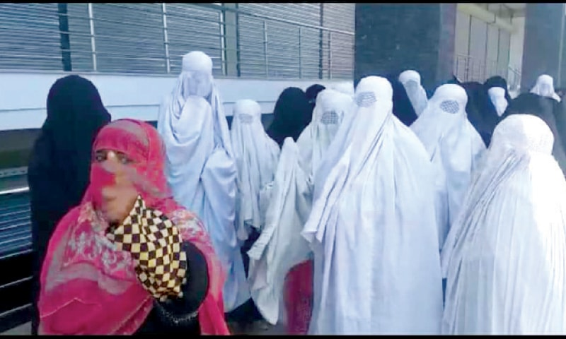 Women stage a protest in Kohat on Tuesday. — Dawn