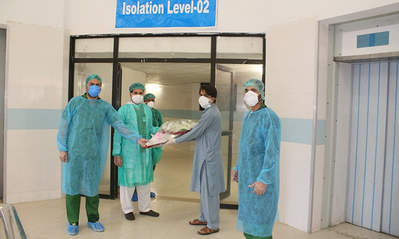 Junaid Khan is seen off by medical staff at Saidu Teaching Hospital. — Photo by author