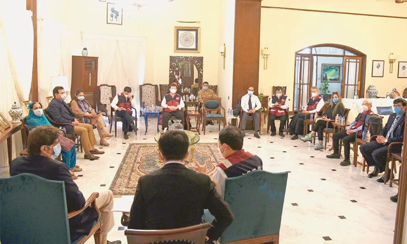Sindh Chief Minister Syed Murad Ali Shah in a meeting with a team of medical experts from China at the CM House on Wednesday. All participants in the meeting wear face masks, which is rare for such official meetings.—PPI