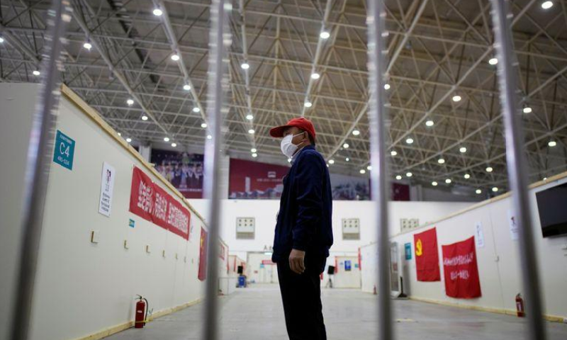 A volunteer is seen inside a convention centre that was used as a makeshift hospital to treat patients with Covid-19, in Wuhan, Hubei province, China, April 9. — Reuters
