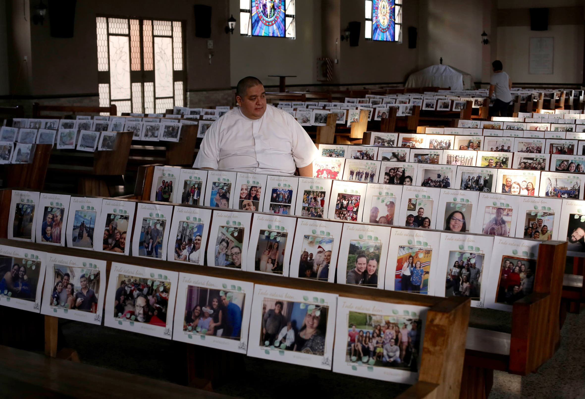Priest Victor Manuel Jimenez sits among photos of the faithful displayed on the church's benches before the live stream of a mass at the Nuestra Senora de Fatima church, as the spread of the coronavirus disease (COVID-19) continues, in San Jose, Costa Rica April 8, 2020. — Reuters