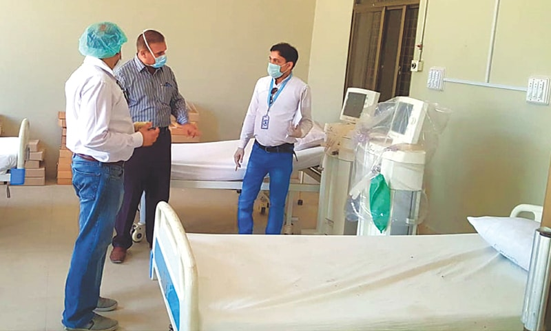 A World Health Organisation official inspects facilities for coronavirus patients at the CMC Hospital in Larkana on Thursday.—PPI