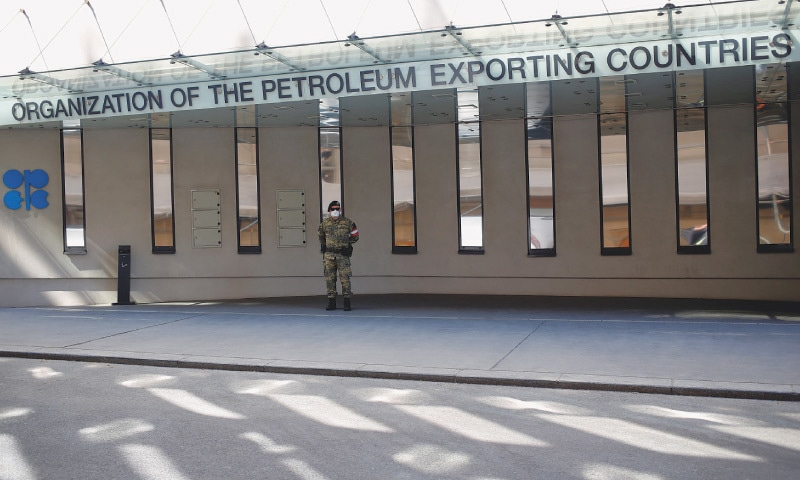 VIENNA: An Austrian army member stands next to the logo of the Organisation of the Petroleum Exporting Countries in front of the headquarters on Thursday.—Reuters