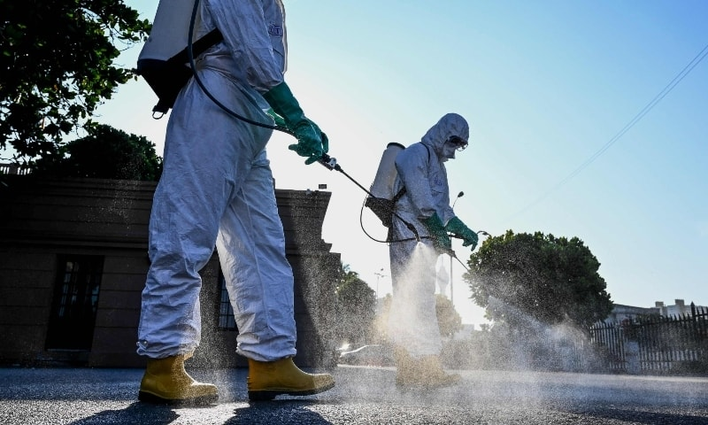 Special Task Force personnel spray disinfectant outside the presidential secretariat in Colombo on April 10 during a government-imposed nationwide lockdown. — AFP