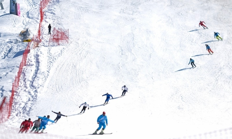 In this picture taken on February 9, skiers take part in the closing ceremony of the Malam Jabba International Alpine Ski Cup 2020. — AFP