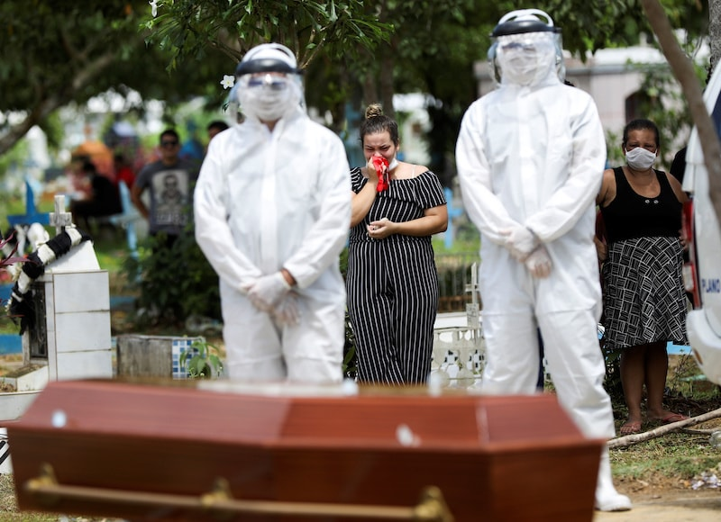 Relatives of 68-years-old Natalina Cardoso Bandeira, who passed away due to coronavirus disease react during her burial at the Parque Taruma cemetery in Manaus, Brazil on April 10, 2020. — Reuters