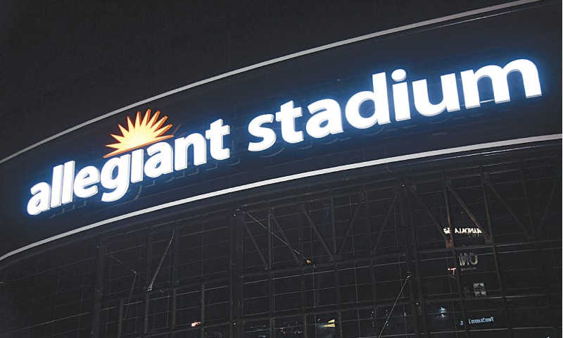 WORKERS test the lighting on an exterior sign at Allegiant Stadium for the first time as construction continues on the $2 billion, glass-domed future home of the Las Vegas Raiders in Nevada, USA. The Raiders are scheduled to begin play at the 65,000-seat facility in their 2020 seasons.—AFP