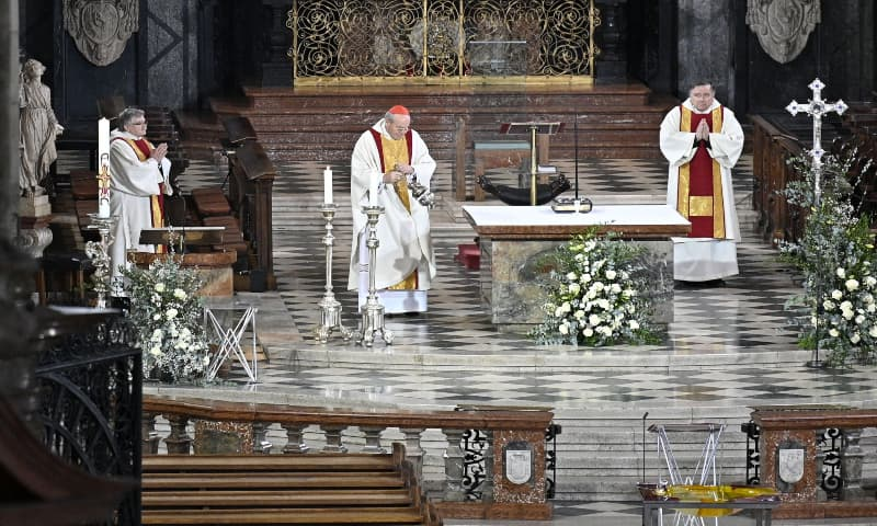 Cardinal Christoph Schoenborn leads an Easter service at the empty Saint Stephen's Cathedral (Stephansdom) due to the novel coronavirus pandemic, on April 12, 2020 in Vienna. — AFP