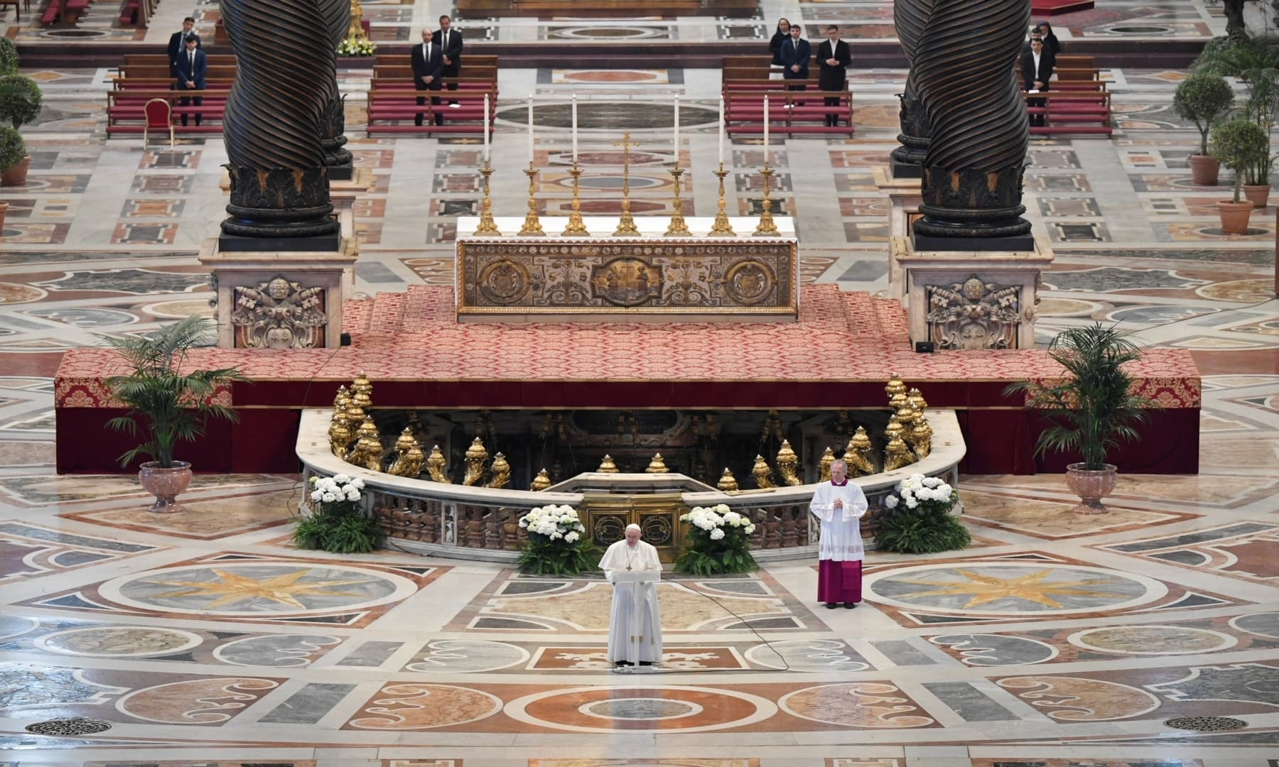 "Pope Francis reads his ""Urbi et Orbi"" (""To the City and the World"") message in St. Peter's Basilica with no public participation on Easter Sunday at the Vatican, on April 12. — Reuters"