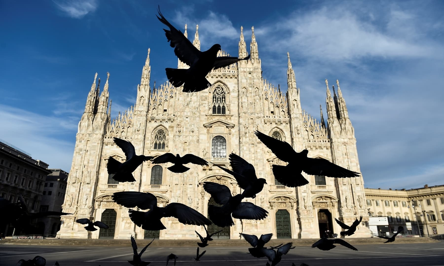 A flock of pigeons fly in front of the Duomo Cathedral on Easter Sunday in Milan, Italy on April 12. — Reuters