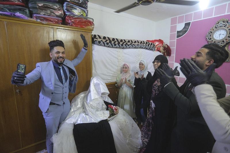 Ahmed Khaled al-Kaabi and his bride Ruqaya Rahim celebrate their wedding. — AP