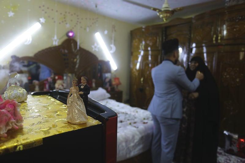 Ahmed Khaled al-Kaabi talks to him mother before his wedding. — AP