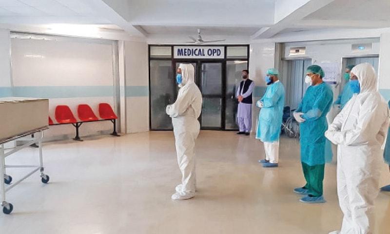 Sher Akbar Khan, one of the volunteers, leads the funeral prayers of a coronavirus victim at Saidu Teaching Hospital. — Dawn