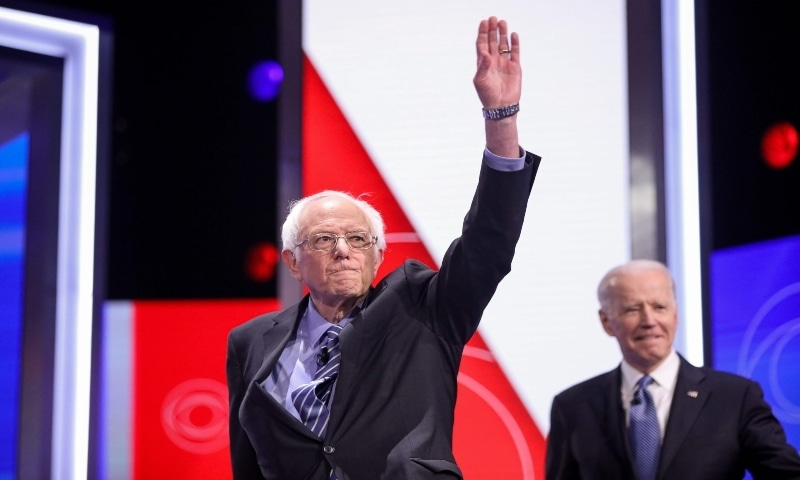 In this photo taken on February 25, 2020 Democratic presidential hopefuls Vermont Senator Bernie Sanders, followed by Former Vice President Joe Biden arrive on stage for the tenth Democratic primary debate of the 2020 presidential campaign season co-hosted by CBS News and the Congressional Black Caucus Institute at the Gaillard Center in Charleston, South Carolina. — AFP