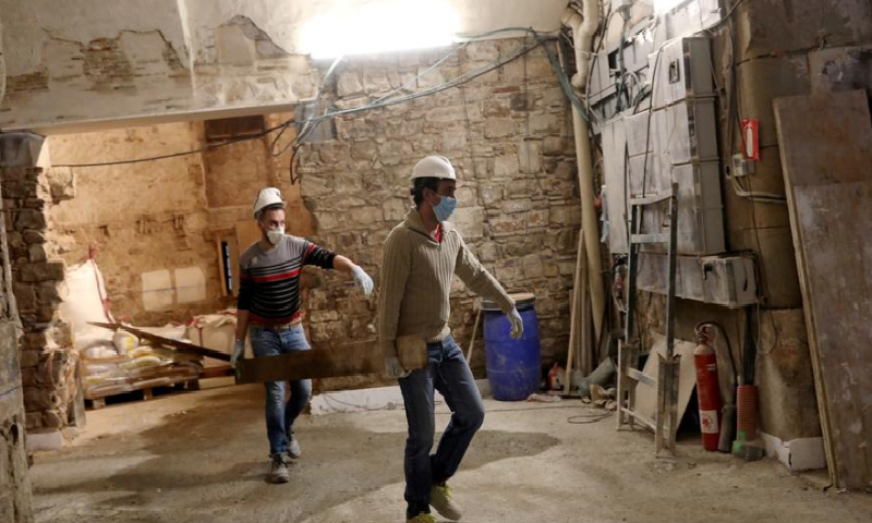 Workers with protective masks work at construction site, following Covid-19 outbreak in Barcelona, Spain April 14. — Reuters