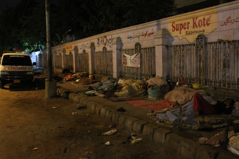 Patients and their attendants sleep on the footpath opposite the SIUT even as the government has imposed a nationwide lockdown to prevent the spread of the novel coronavirus. These patients are the most vulnerable as their immune systems are already weak. — Photo by author