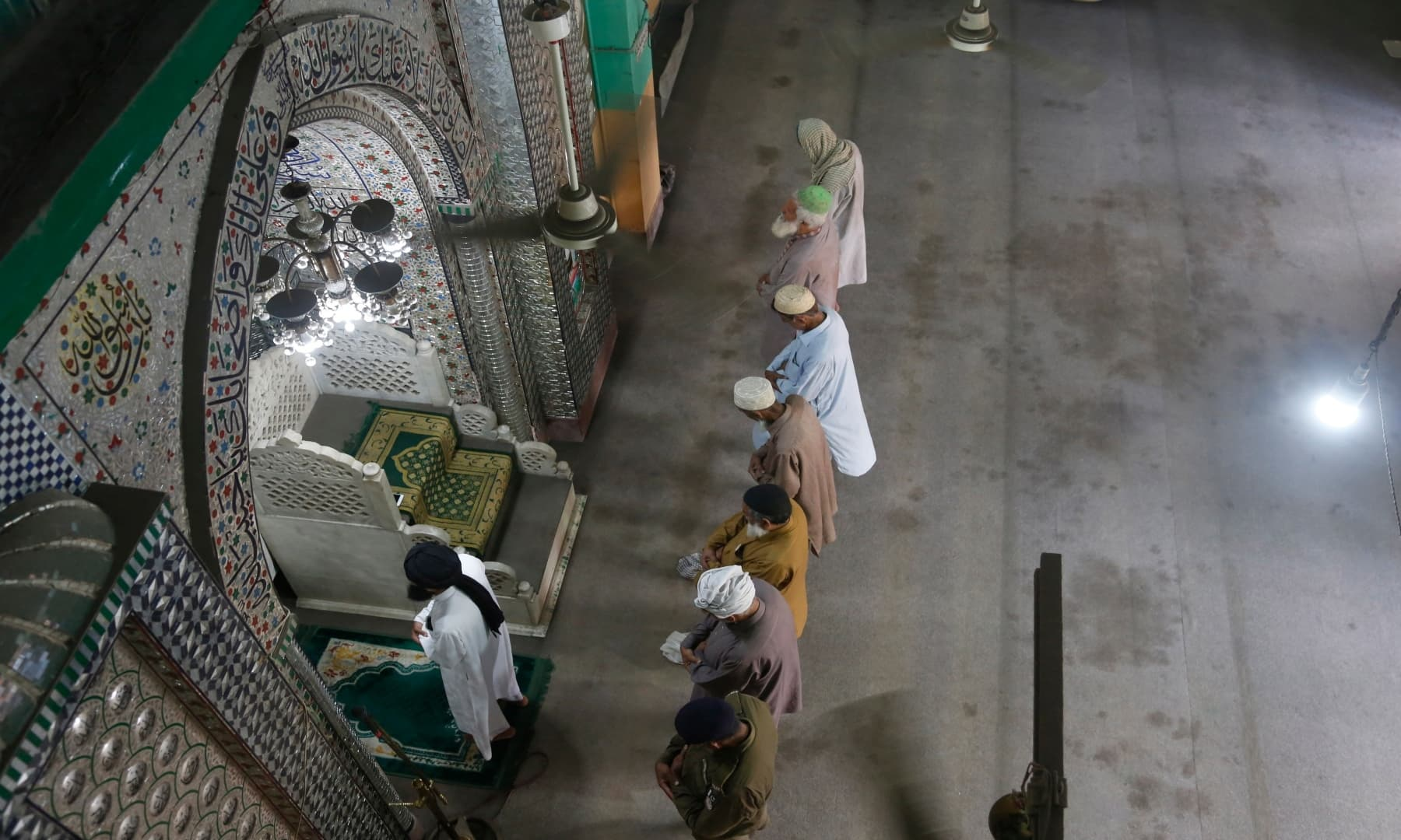 People offer Friday prayers at a mosque in Lahore. — AP