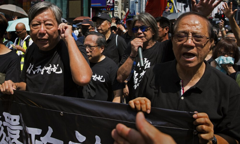 In this Tuesday, Oct. 1, 2019, photo, from right, former pro-democracy lawmakers Yeung Sum, Leung Kwok-hung, Albert Ho, Lee Cheuk-yan attend a pro-democracy protest in Hong Kong. — AP