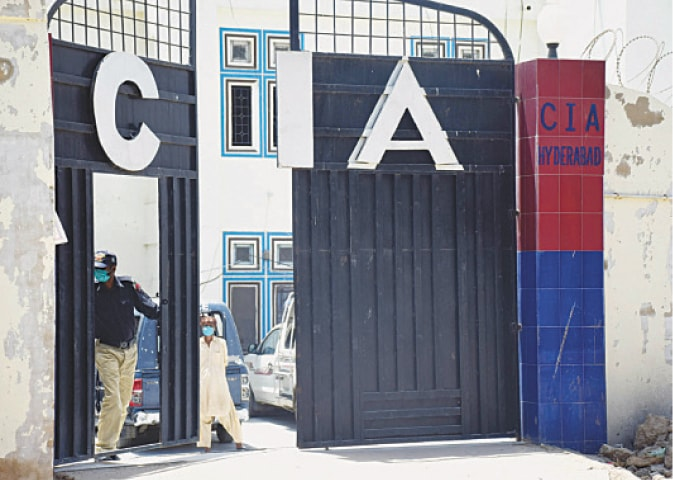 A POLICEMAN stands guard at the CIA centre in Hyderabad on Monday  where a DSP and scores of other policemen have been kept in  quarantine.—Dawn