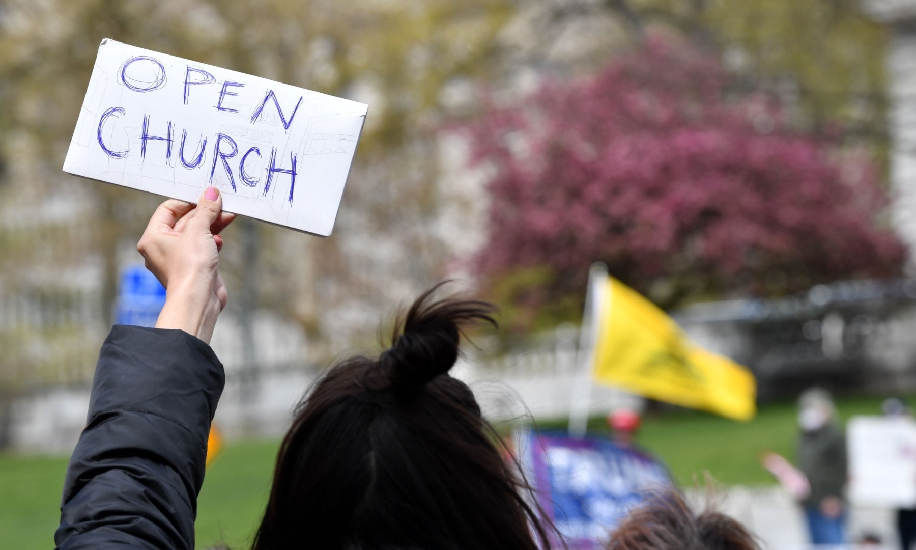 """People take part in a """"reopen"""" Pennsylvania demonstration on April 20 in Harrisburg, Pennsylvania.  — AFP"""