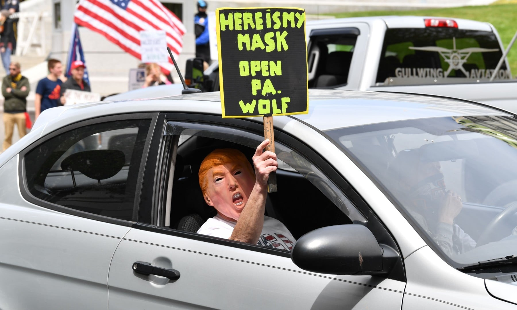 """A man takes part in a """"reopen"""" Pennsylvania demonstration on April 20 in Harrisburg, Pennsylvania.  — AFP"""