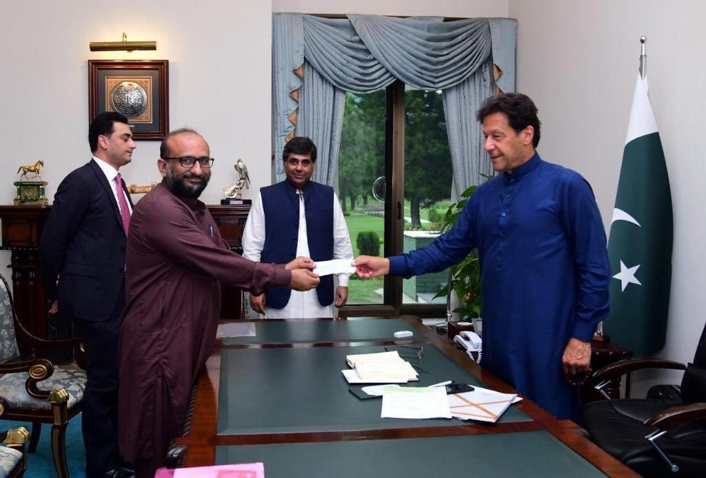 This picture was taken on April 15 in Islamabad when Faisal Edhi met Prime Minister Imran Khan and handed over a Rs10 million cheque for the premier's coronavirus relief fund. — Via PTI Twitter