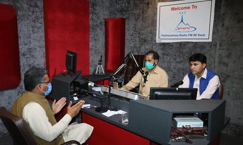 A health expert and broadcasters attend the radio clinic at Pakhtunkhwa Radio FM 98. — Photo by author