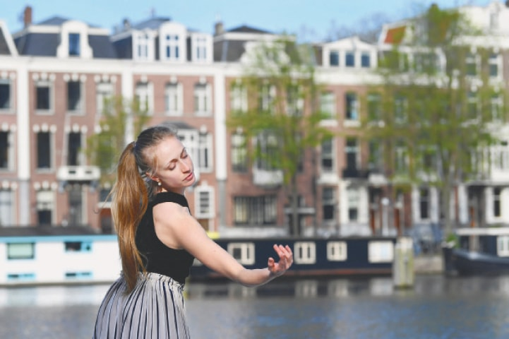 "Amsterdam: Ballet dancer Yvonne Slingerland Cosialls of the Dutch National Ballet performs on the streets of Amsterdam for the ""Gently Quiet"" project amid the coronavirus disease outbreak.—Reuters"