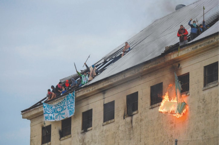 Buenos Aires: Inmates from Villa Devoto prison burn mattresses during a riot on Friday. They called upon the authorities to take measures to prevent the spread of the coronavirus.—AFP