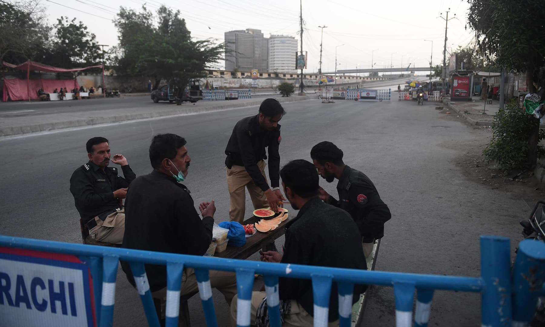 Policemen pray before breaking their fast at a checkpoint on the first day of Ramazan in Karachi on April 25. — AFP