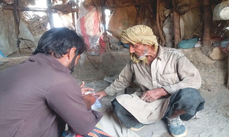 Abdur Rehman's occasional visitor, his nephew Khalil, hands over monthly ration to his uncle | Photos by the writer