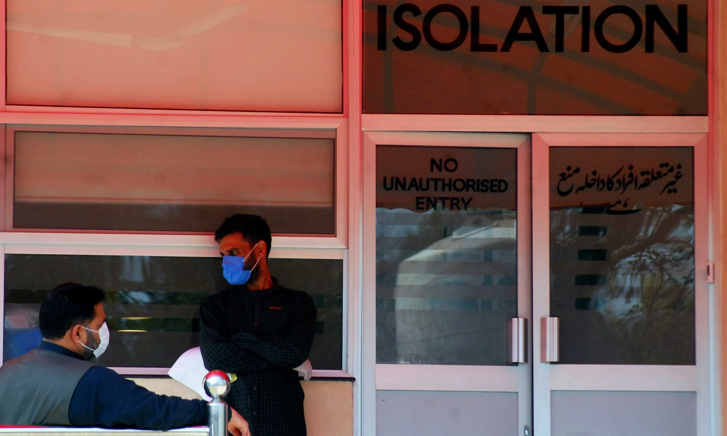 Men wear protective masks as a preventive measure against coronavirus, as they stand outside the Isolation Ward at the Pakistan Institute of Medical Sciences (Pims) in Islamabad, March 15, 2020. — Reuters