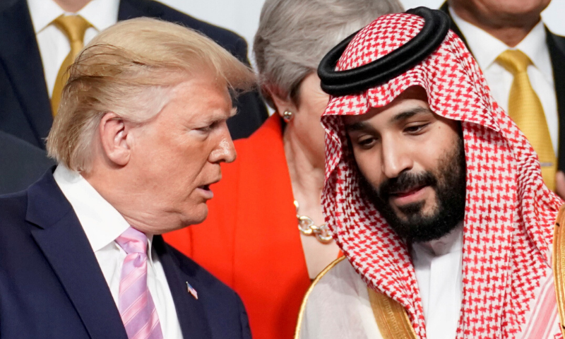US President Donald Trump speaks with Saudi Arabia's Crown Prince Mohammed bin Salman during a family photo session with other leaders and attendees at the G20 leaders summit in Osaka, Japan, June 28, 2019. — Reuters/File