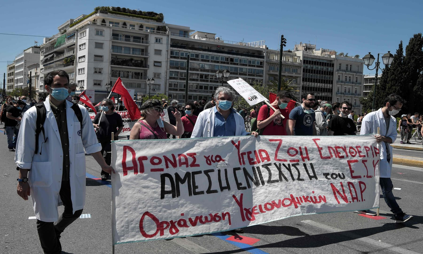 Doctors attend the Labour Day demonstration in Athens, Greece amid the country's lockdown to stem the spread of the Covid-19. — AFP