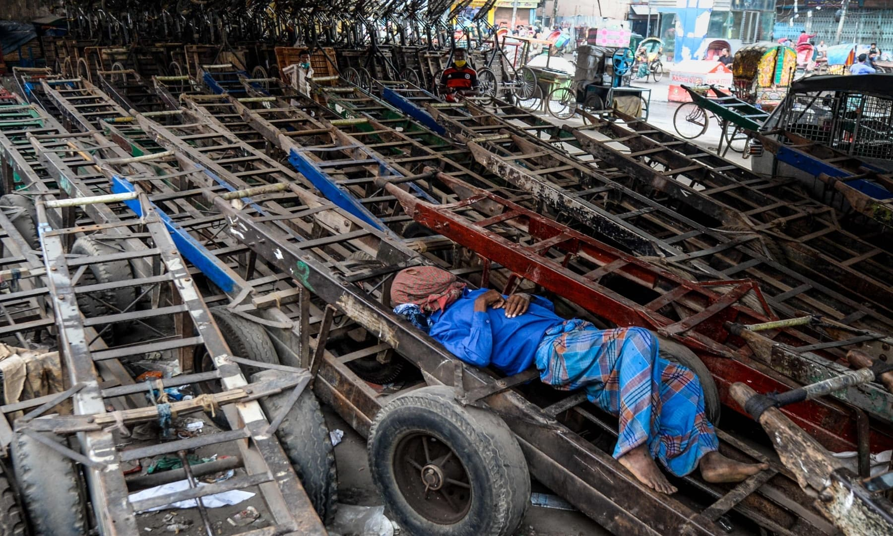 A labourer sleeps on a pushcart on Labour Day in Dhaka, Bangladesh. — AFP