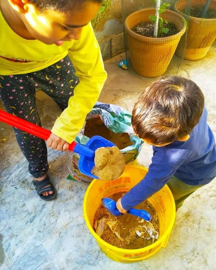 Maaz Virani making compost for his garden with his younger brother | Courtesy Sanjeeda Dawood
