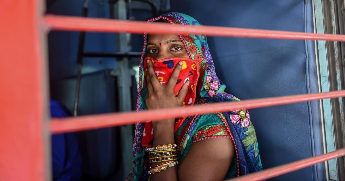 A migrant worker on a special train headed to Agra from Sabarmati Railway Station amid the Covid-19 lockdown. — AFP