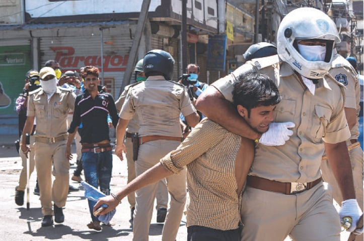 Indian police clash with workers