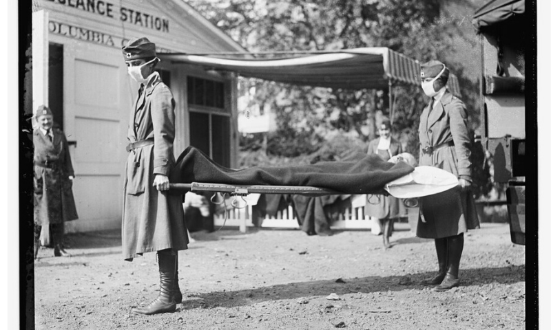 This Library of Congress photo shows a demonstration at the Red Cross Emergency Ambulance Station in Washington, DC, during the influenza pandemic of 1918. — AP