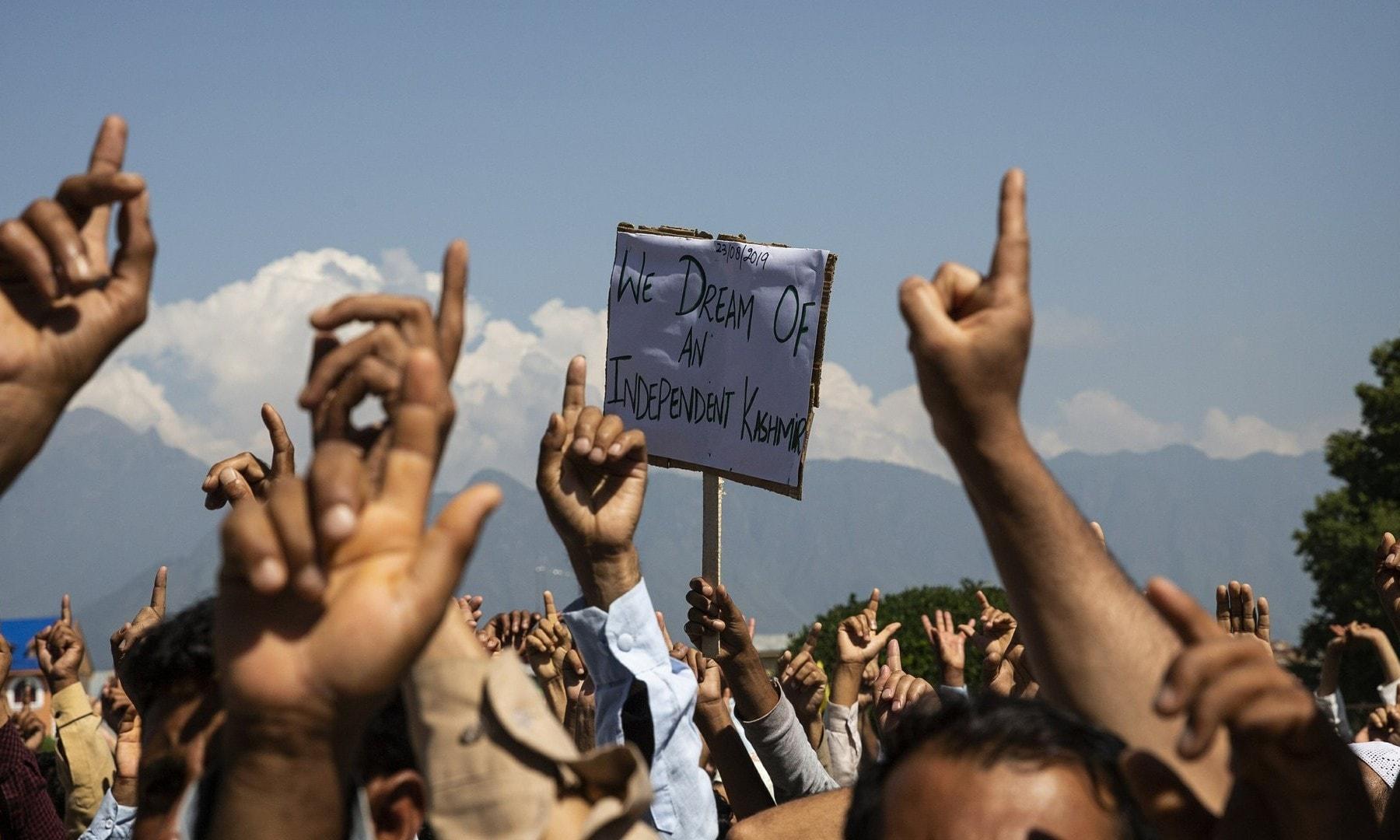 Kashmiri men shout freedom slogans during a protest against New Delhi's tightened grip on the region on August 23, 2019. — AP/Dar Yasin