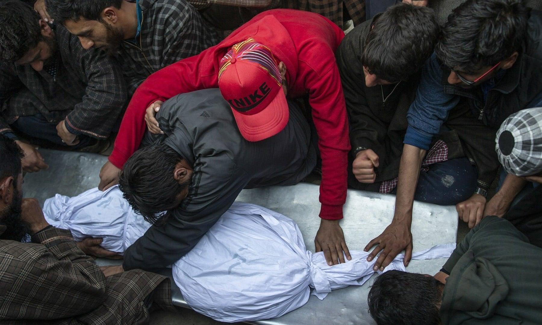 Kashmiri villagers grieve near the body of an 11-year-old boy, Aatif Mir, during his funeral procession in Hajin village on March 22, 2019. — AP/Dar Yasin