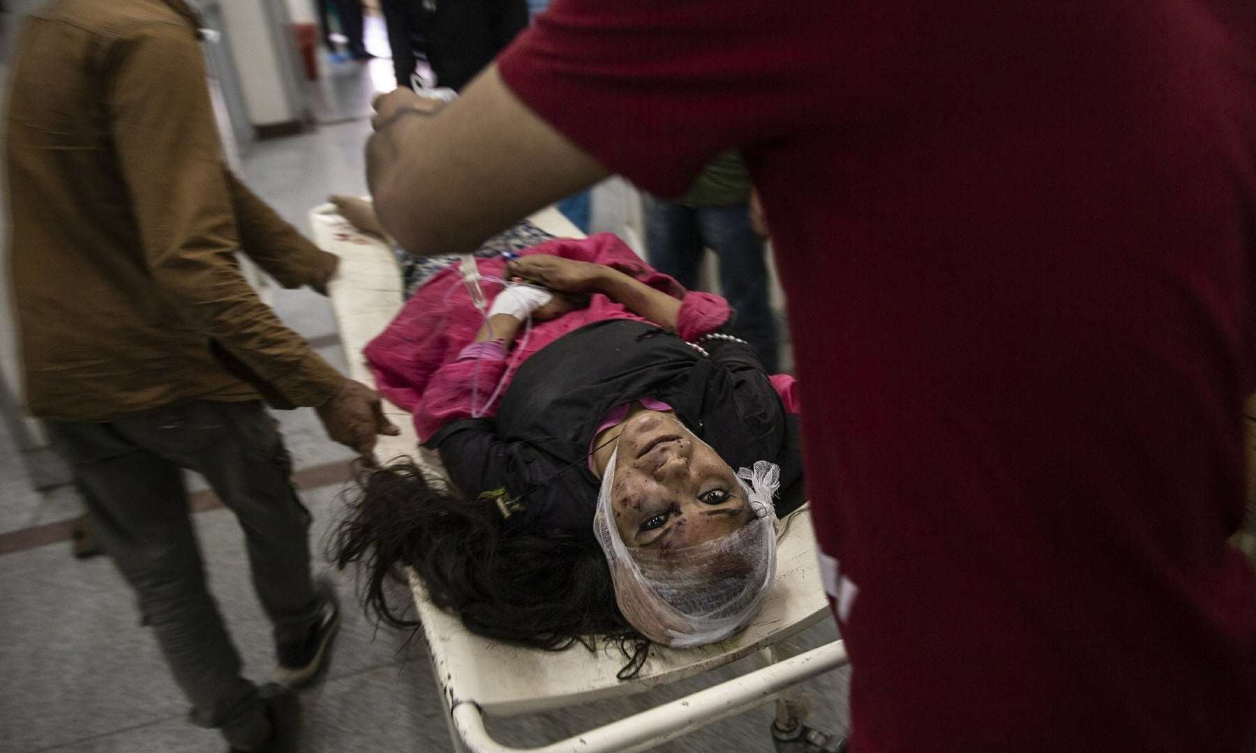 A wounded woman is carried on a stretcher for treatment after she was injured in a bus accident, at a local hospital in Srinagar on June 27, 2019.  — AP/Dar Yasin