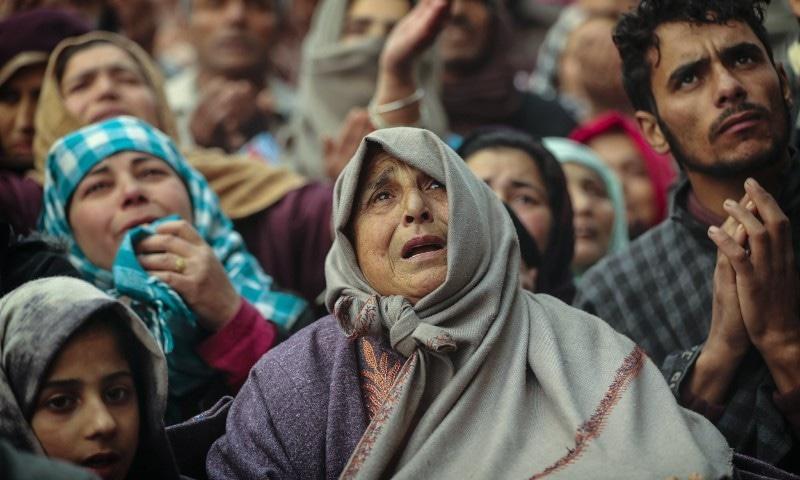 یہ تصویری ایوارڈ جیتنے والے مختار خان نے دسمبر 2019 میں شیخ سید عبدالقادر جیلانی کے مزار کے باہر کھینیچ تھی—فوٹو: اے پی