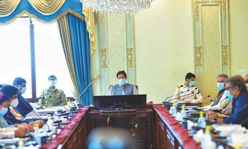 ISLAMABAD: Prime Minister Imran Khan and federal ministers, all wearing masks, attend a meeting.—PPI