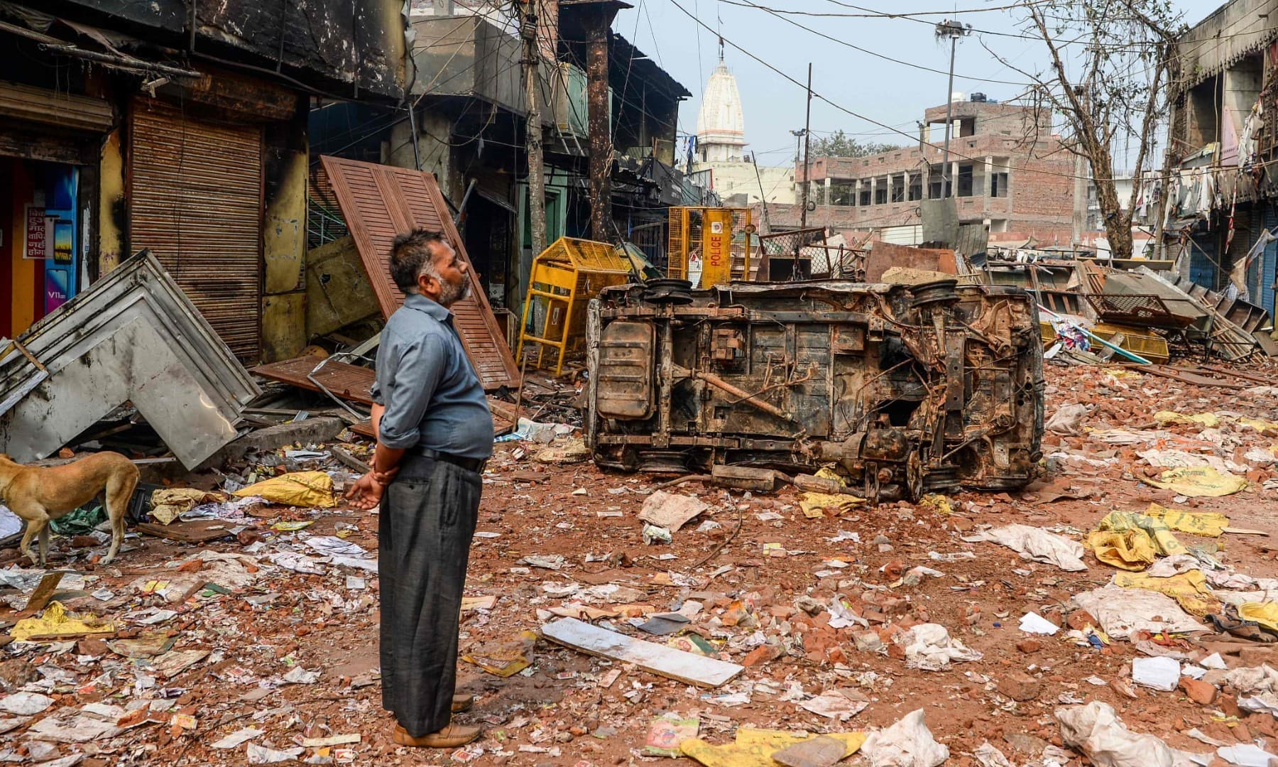 In this file photo taken on February 26, a resident stands among debris in a neighbourhood following clashes between people supporting and opposing a contentious amendment to India's citizenship law in Delhi. — AFP