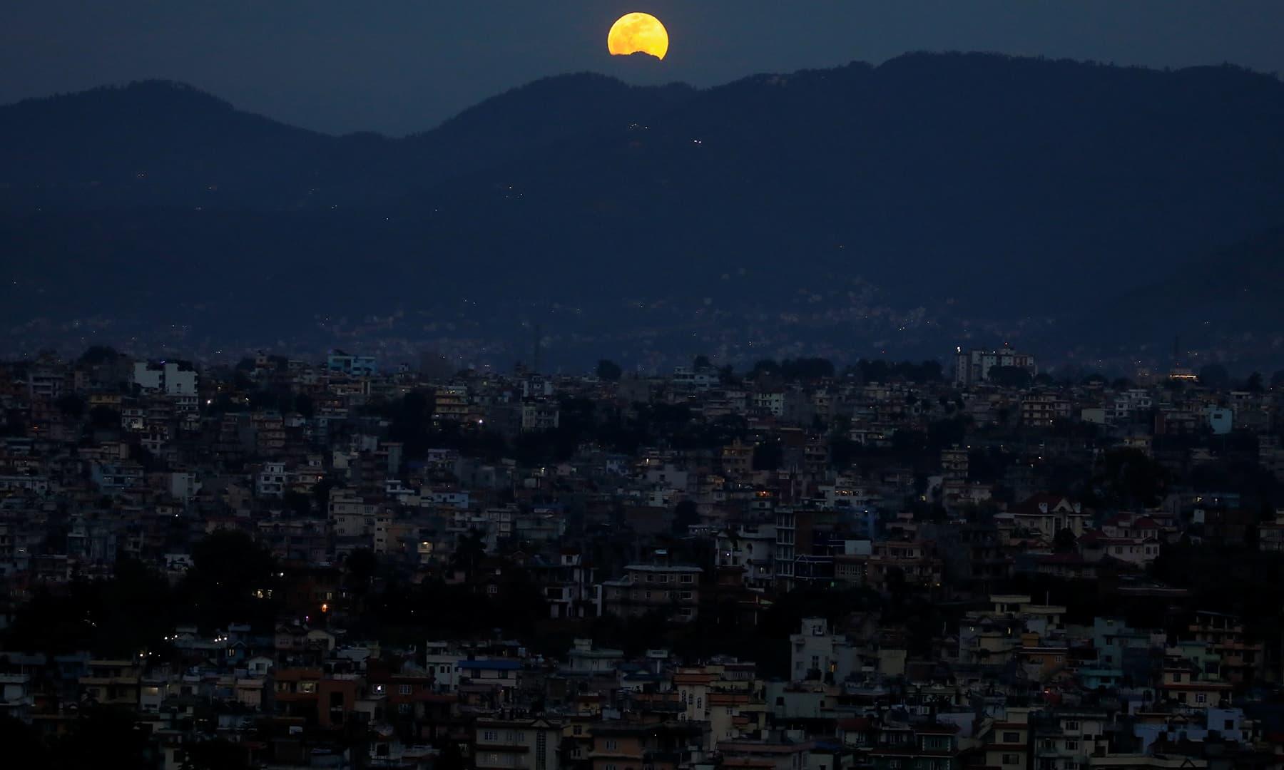 The full moon rises above the Kathmandu Valley in Kathmandu, Nepal. — Reuters