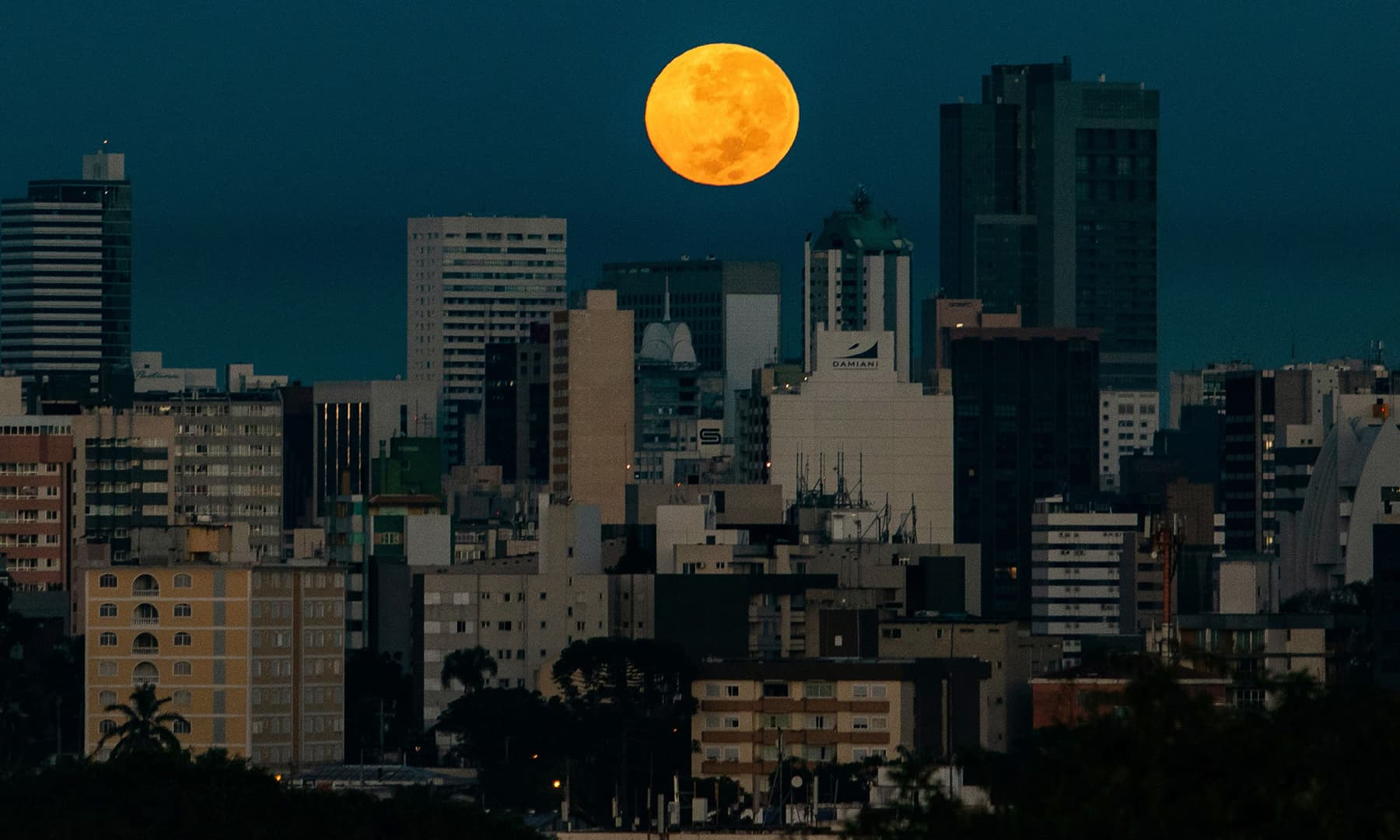 The Flower Supermoon rises over Curitiba, Brazil on May 7. — AFP