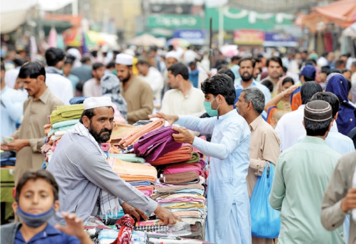 A large number of people throng Rawalpindi's Bara Market on Friday. — Photo by Mohammad Asim