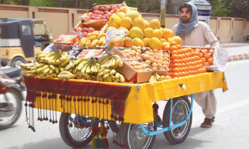 QUETTA: Vendor selling fruits in provincial street on Friday. ILO says the Covid-19 lockdowns threaten to increase relative poverty levels among the world's informal economy workers by as much as 56 percentage points in low-income countries.—INP
