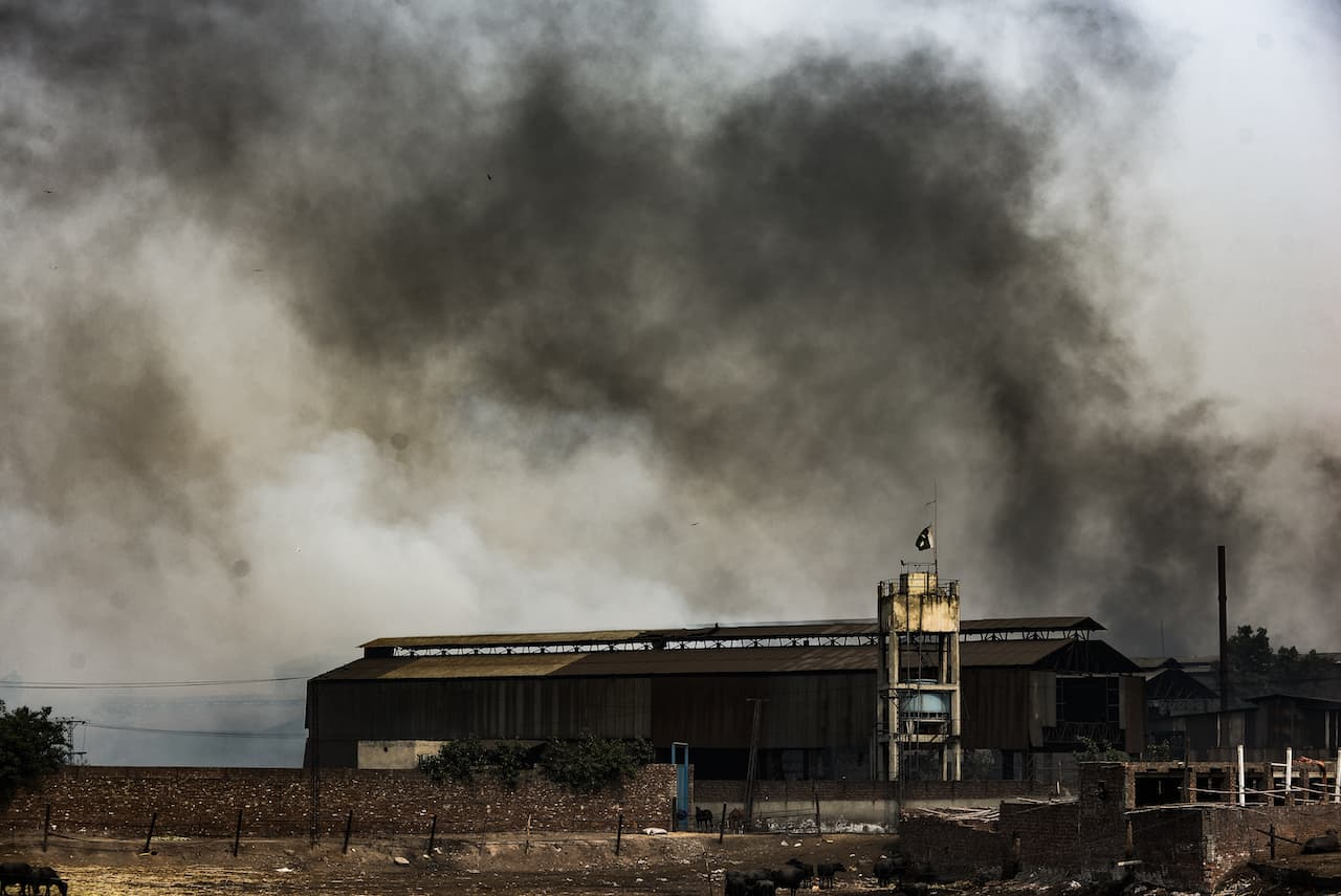 An archival photo of smoke rising from a factory in Karachi | Murtaza Ali, White Star